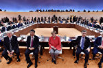 Президент США Дональд Трамп, президент Китая Си Цзиньпин, канцлер Германии Ангела Меркель, президент Аргентины Маурисио Макри и премьер-министр Австралии Малкольм Тернбулл перед первой рабочей сессией G20 в Гамбурге, Германия, 7 июля 2017 года