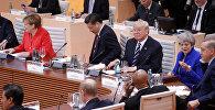 Лидеры стран в ходе первой рабочей сессии G20 в Гамбурге, Германия, 7 июля 2017 года