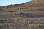 Древние могилы в горной цепи Пештасар