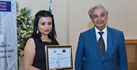 Журналист Sputnik Азербайджан Ирада Джалиль и Исмаил Садыгов