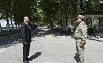 Начальник Генштаба ВС Наджмеддин Садыков отдает рапорт Верховному Главнокомандующему Ильхаму Алиеву