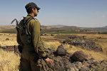 Израильский солдат на границе с Сирией, 24 июня 2017 года