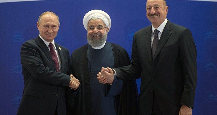 Президент РФ Владимир Путин, президент ИРИ Хасан Рухани и президент АР Ильхам Алиев