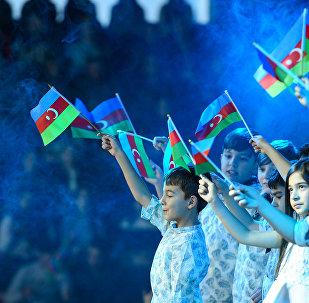 Четвертый фестиваль флага, посвященный празднованию Дня Государственного флага, в Бакинском дворце спорта