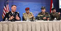 İŞİD-ə qarşı beynəlxalq koalisiyanın amerikalı mətbuat katibi Rayn Dilon (solda)