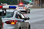Автомобили полиции на улице Москвы, фото из архива
