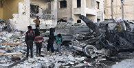 Разрушенное в результате взрыва здание в сирийском Идлибе, 8 января 2018 года