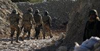 Поддерживаемые Турцией бойцы сирийской армии  на горе Барсая, к северо-востоку от Африна, Сирия 28 января 2012 года