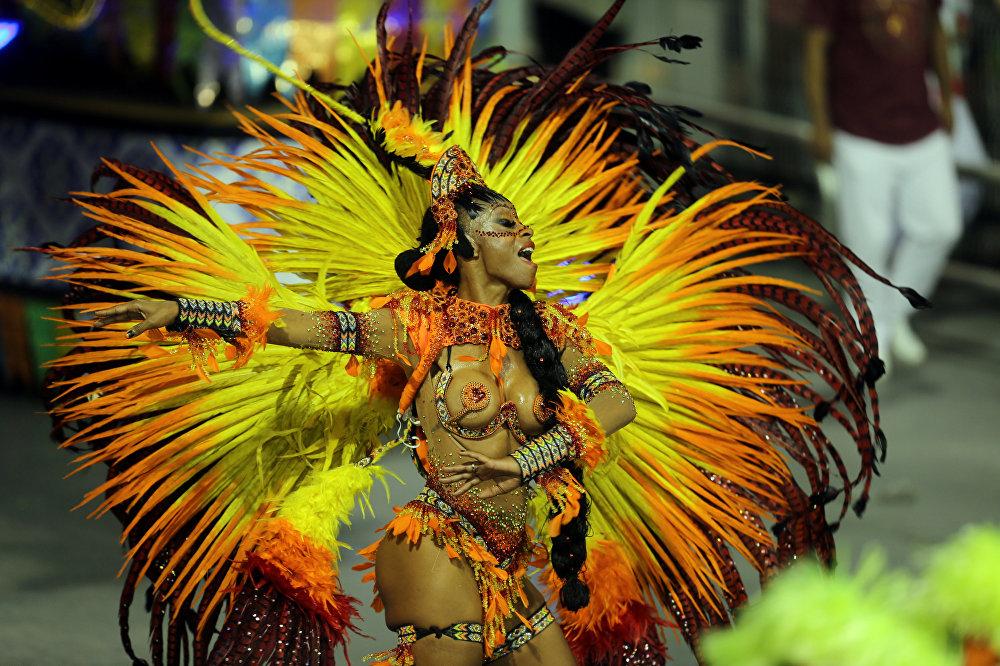 A reveller from the Mocidade Alegre Samba School takes part in Carnival at Anhembi Sambadrome in Sao Paulo, Brazil February 11, 2018