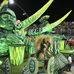 Dancers from the Unidos do Peruche samba school perform on a float during a carnival parade in Sao Paulo, Brazil, Saturday, Feb. 10, 2018