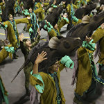 Dancers from the Imperio de Casa Verde samba school perform during a carnival parade in Sao Paulo, Brazil, Sunday, Feb. 11, 2018