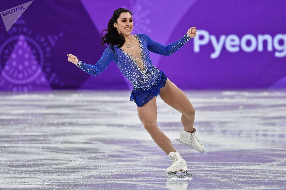 Габриэль Дэйлман (Канада) выступает в произвольной программе женского одиночного катания командных соревнований по фигурному катанию на XXIII зимних Олимпийских играх