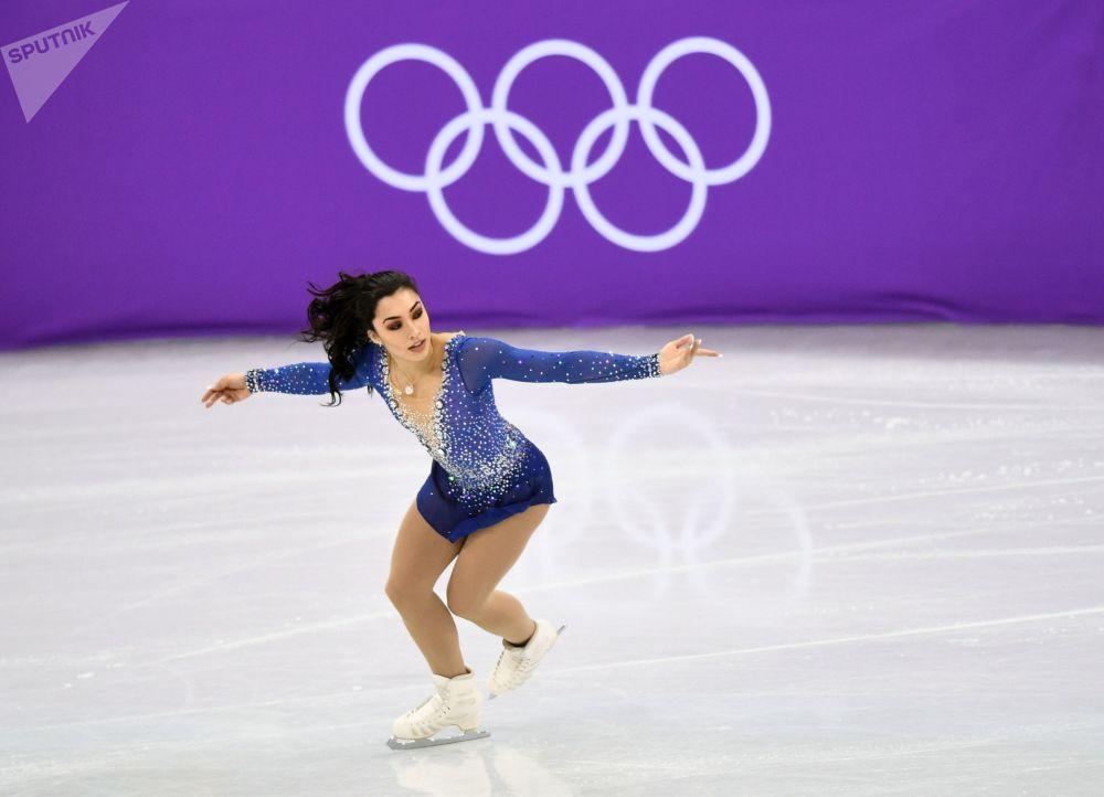 Канадская фигуристка Габриэль Дэйлман выступает в произвольной программе женского одиночного катания командных соревнований по фигурному катанию на XXIII зимних Олимпийских играх