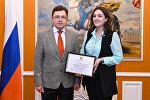 Временный поверенный в делах России в Азербайджане Олег Мурашев и журналист Sputnik Азербайджан Камилла Алиева
