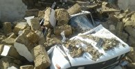 Автомобиль, оставшийся под обломками обрушившегося здания